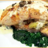 SALMON STUFFED WITH ARTICHOKE & SUN-DRIED TOMATOES, WITH A LEMON CAPER SAUCE!