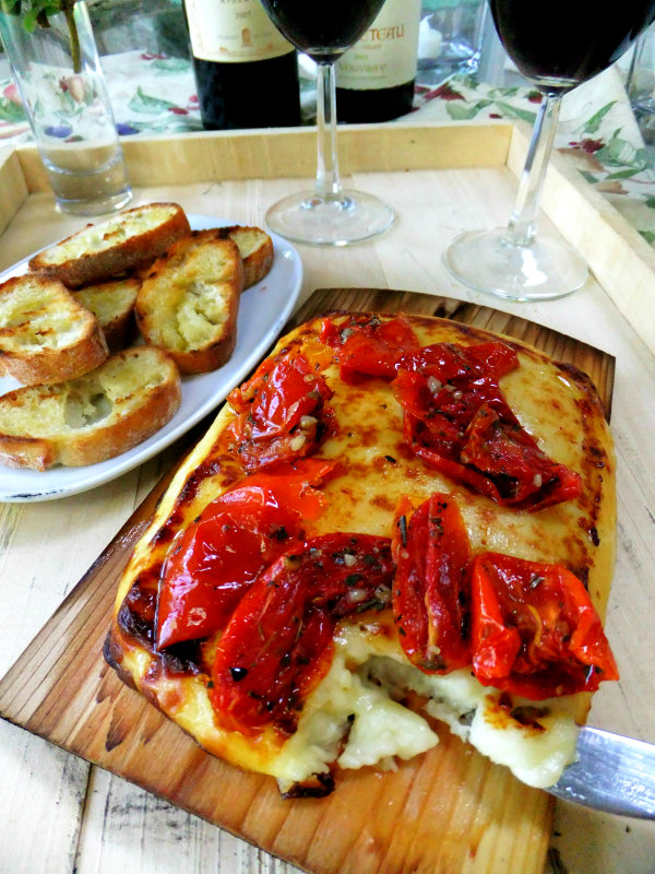 planked cheese with tomatoes