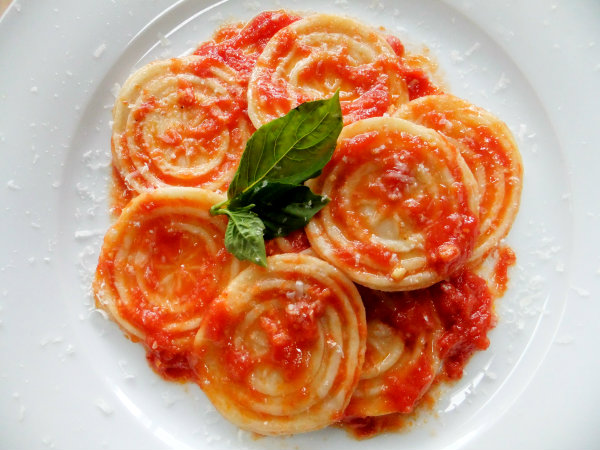 corzetti pasta with sauce