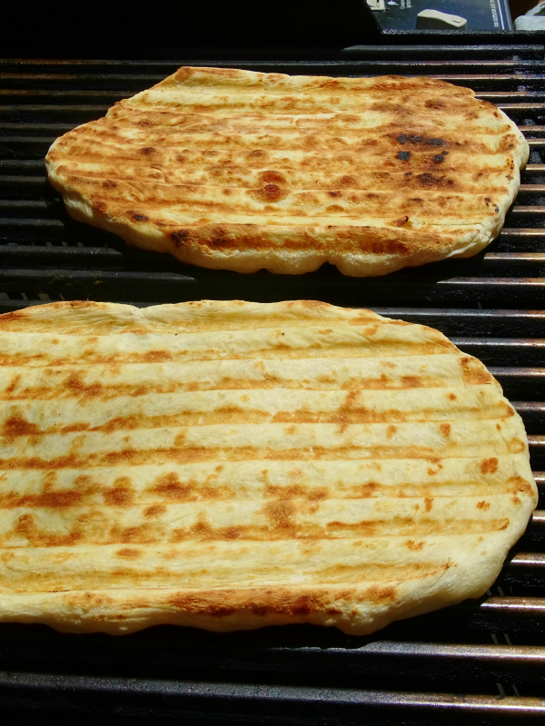making grilled pizza